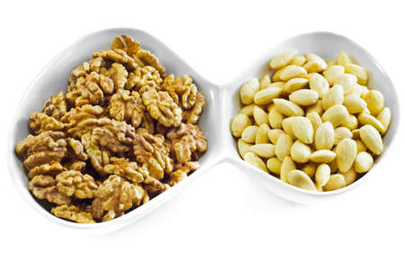 Almonds and Walnuts isolated on white background. Stock Photo