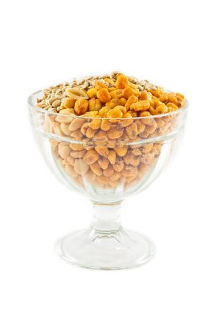 Fried Corn, Peanut and Sunflower Seeds in glass container isolated on white background. Stock Photo
