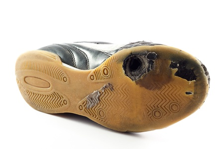 Worn out sports Shoe with hole on bottom, white background. Stock Photo - 11965761