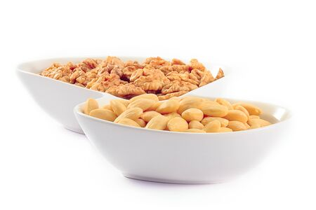 Almonds and Walnuts on white background. Stock Photo