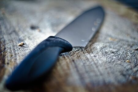 Big kitchen knife on a cutting board. Stock Photo - 12067839