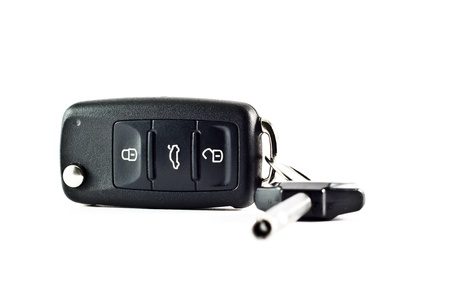 A set of car keys over white background.