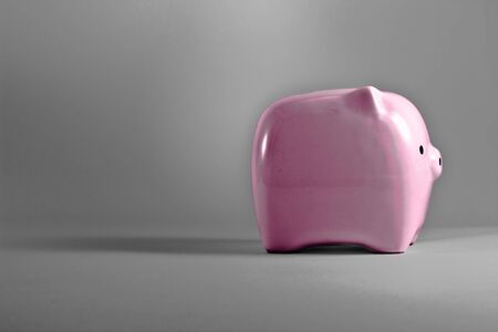 Pink piggy bank saving or money-box. Stock Photo