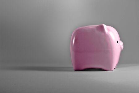 moneybox: Pink piggy bank saving or money-box. Stock Photo