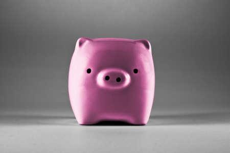 Pink piggy bank saving or money-box. Stock Photo