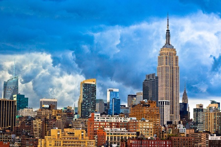 chrysler building: New York City skyline on cloudy day  View of Empire State building and Chrysler building