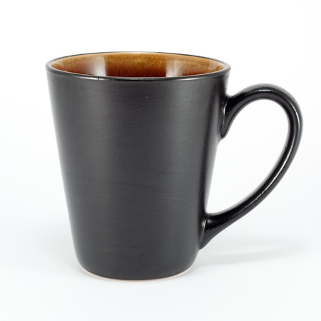 Black mug isolated on white background. Stock Photo