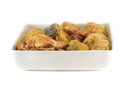 Stuffed Cabbage Leafs and smoked Salmon, meatless dish, on white background  Stock Photo