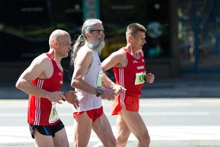 Belgrade, Serbia - April 21, 2018: Runners from Switzerland taking part in 31st Belgrade Marathon Editorial