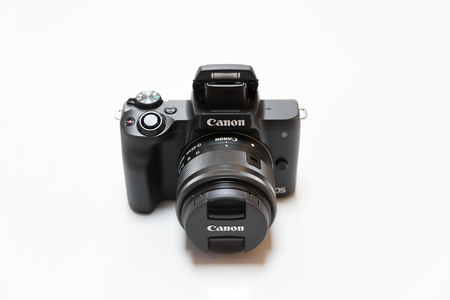 Belgrade, Serbia - May 05, 2018: New Canon mirrorless, interchangeable lens camera, EOS M50 with 15-45 mm zoom lens is displayed on white background Editorial
