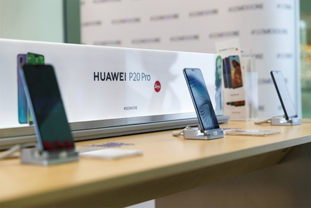 Belgrade, Serbia - March 29, 2018: New Huawei P20 Pro Smartphones is displayed on demo stands in electronic store. Brand logo in the background. Editorial