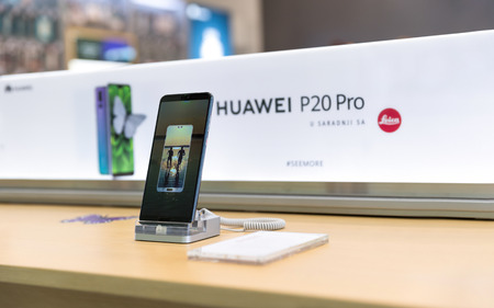 Belgrade, Serbia - March 29, 2018: Newly launched Huawei P20 Pro Smartphones is displayed on demo stands in electronic store. Brand logo in the background. Editorial