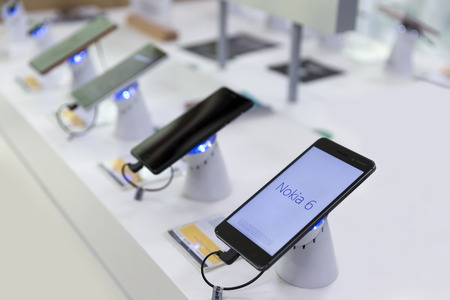 Belgrade, Serbia - May 05, 2018: Nokia 6 Smartphone is displayed with brand logo screen in electronic store.