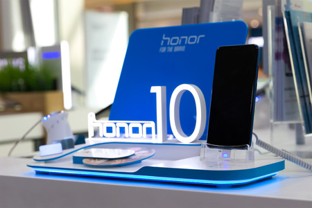 Belgrade, Serbia - Jun 23, 2018: New Honor 10, mobile Smartphone is displayed on brand logo stand in electronic store.