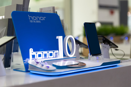 Belgrade, Serbia - Jun 23, 2018: New Honor 10, mobile Smartphone is shown on brand logo stand in electronic store. Editorial