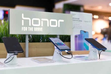 Belgrade, Serbia - Jun 23, 2018: New Honor Smartphones are shown on display in electronic store. Brand logo in the background.