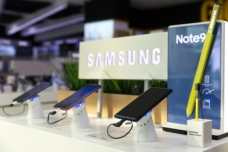 Belgrade, Serbia - August 14, 2018: Samsung Galaxy Note 9 Smartphone is shown on retail display in electronic store. Brand logo in the background.