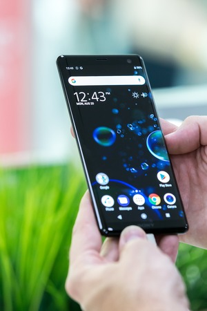 Belgrade, Serbia - October 12, 2018: New SONY Xperia XZ3 is displayed with home screen in hand. Mobile smartphone with apps on the screen in electronic store.