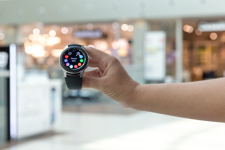 Belgrade, Serbia - September 13, 2018: New Samsung Galaxy Watch 46 mm - SM-R800 is displayed in hand against isolated blurry background. New gadget with apps on the screen is here.