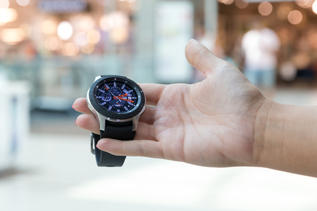 Belgrade, Serbia - September 13, 2018: New Samsung Galaxy Watch 46 mm - SM-R800 is displayed in hand on isolated background. New gadget showing time.