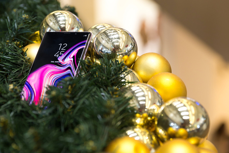 Belgrade, Serbia - November 30, 2018: New Samsung Galaxy Note 9 mobile smartphone is displayed as a gift in Christmas decoration.