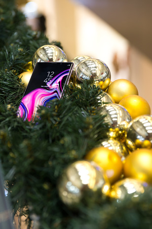 Belgrade, Serbia - November 30, 2018: New Samsung Galaxy Note 9 mobile smartphone is shown as a gift in Christmas decoration. Editorial