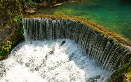 Krupajsko Vrelo beautiful thermal waterfall in Serbia. Spring of healing water. The Krupaj Springs. Stock Photo