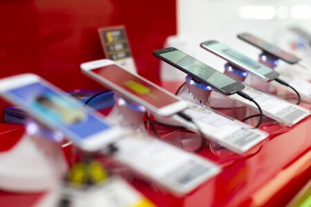 Belgrade, Serbia - March 16, 2017: New mobile smartphones are shown on retail display in electronic store. Digital gadgets with touchscreen for internet and telecommunication. Editorial