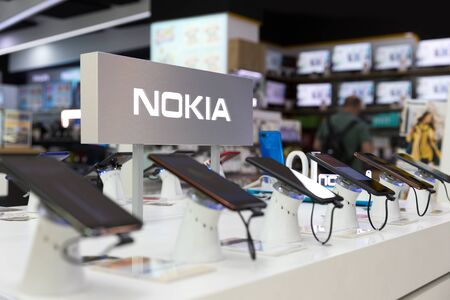 Belgrade, Serbia - Jun 06, 2019: New Nokia mobile smartphones are shown on retail display in electronic store. Brand logo in the background.