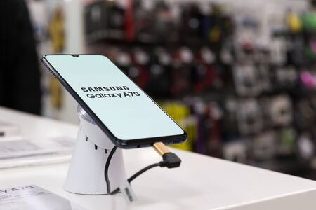 Belgrade, Serbia - May 08, 2019: New Samsung Galaxy A70 mobile smartphone is displayed on retail display in electronic store.