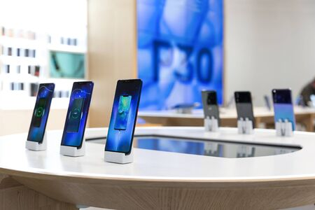 Belgrade, Serbia - March 20, 2019: Huawei mobile smartphones are shown on retail display in electronic store. New P30 logo in the background.