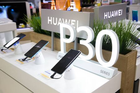 Belgrade, Serbia - April 05, 2019: New Huawei P30 Pro mobile smartphones are shown on retail display in electronic store. Huawei and P30 logo in the background.