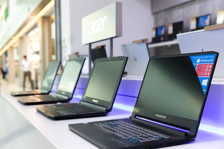 Belgrade, Serbia - May 08, 2019: New Acer Predator laptop computers are displayed on white table in electronic store.