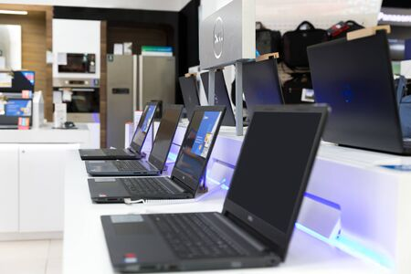Belgrade, Serbia - February 15, 2019: New Dell laptop computers are displayed on white table in electronic store.