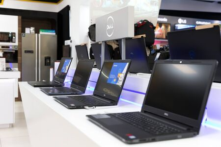 Belgrade, Serbia - February 15, 2019: New Dell laptop computers are shown on white table in electronic store.