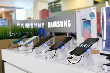 Belgrade, Serbia - April 05, 2019: New Samsung Galaxy A50 mobile smartphone is displayed on retail display in electronic store. Brand logo in the background.