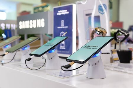 Belgrade, Serbia - May 08, 2019: New Samsung Galaxy A70 mobile smartphone is displayed on retail display in electronic store. Brand logo in the background.