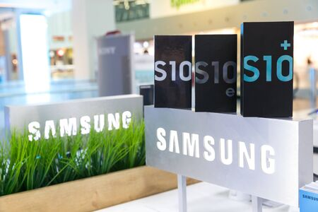Belgrade, Serbia - March 20, 2019: New Samsung Galaxy S10, S10e and S10+ mobile smartphones in original cardboard boxes are displayed on brand logo sign in electronic store.