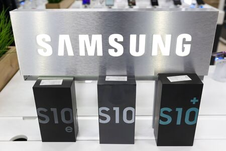 Belgrade, Serbia - March 20, 2019: New Samsung Galaxy S10, S10e and S10+ mobile smartphones in original cardboard boxes are displayed in electronic store. Brand logo in the background.