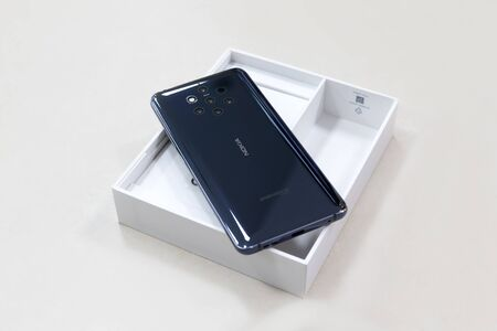 Belgrade, Serbia - May 08, 2019: New Nokia 9 Pure View mobile smartphone is displayed from rear side on cardboard box. Flagship gadget on isolated white background.
