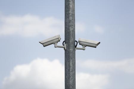 metal pole: Two security cctv camera on a metal pole