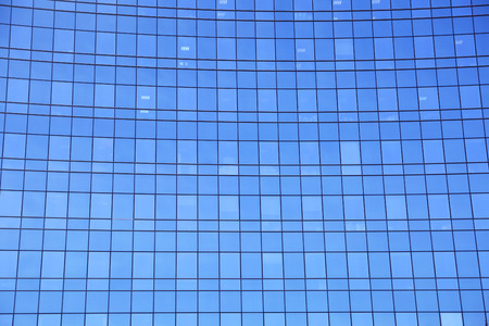 reflect: Modern facade of glass and steel reflecting sky Stock Photo