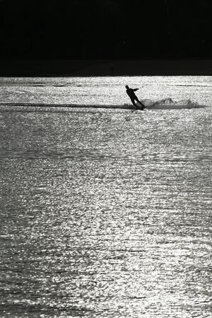 waterskiing: Silhouette waterskiing man in lake black and white picture Stock Photo