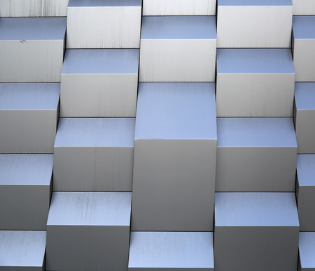 fragmentation: 3d metal wall with curves in the shadows Stock Photo