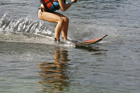 water skier: A Water Skier in performance Water Skiing sport on a Lake