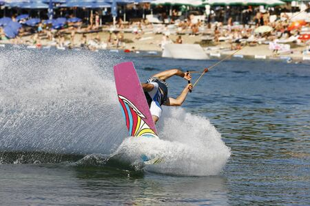 waterskiing: A Water Skier in performance Water Skiing sport on a Lake
