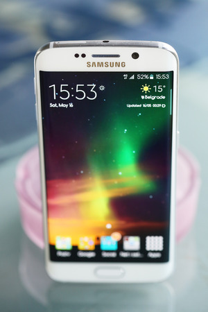 mp: Belgrade, Serbia - May 16, 2015: Illustrative Mobile phone White Pearl  Samsung Galaxy 6 EDGE With curved glass and metal with 16 mp Camera.
