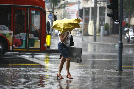 rain weather: Belgrade, Serbia - Jun 30, 2014: People in the town during heavy rain. Walking with an umbrella on June in Belgrade, Serbia.