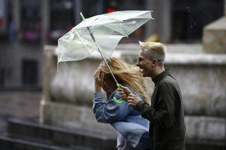 Belgrade, Serbia - Jun 30, 2014: People in the town during heavy rain. Walking with an umbrella on June in Belgrade, Serbia.