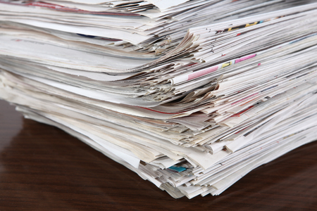 pile of newspapers: Old Newspapers and magazines on a pile